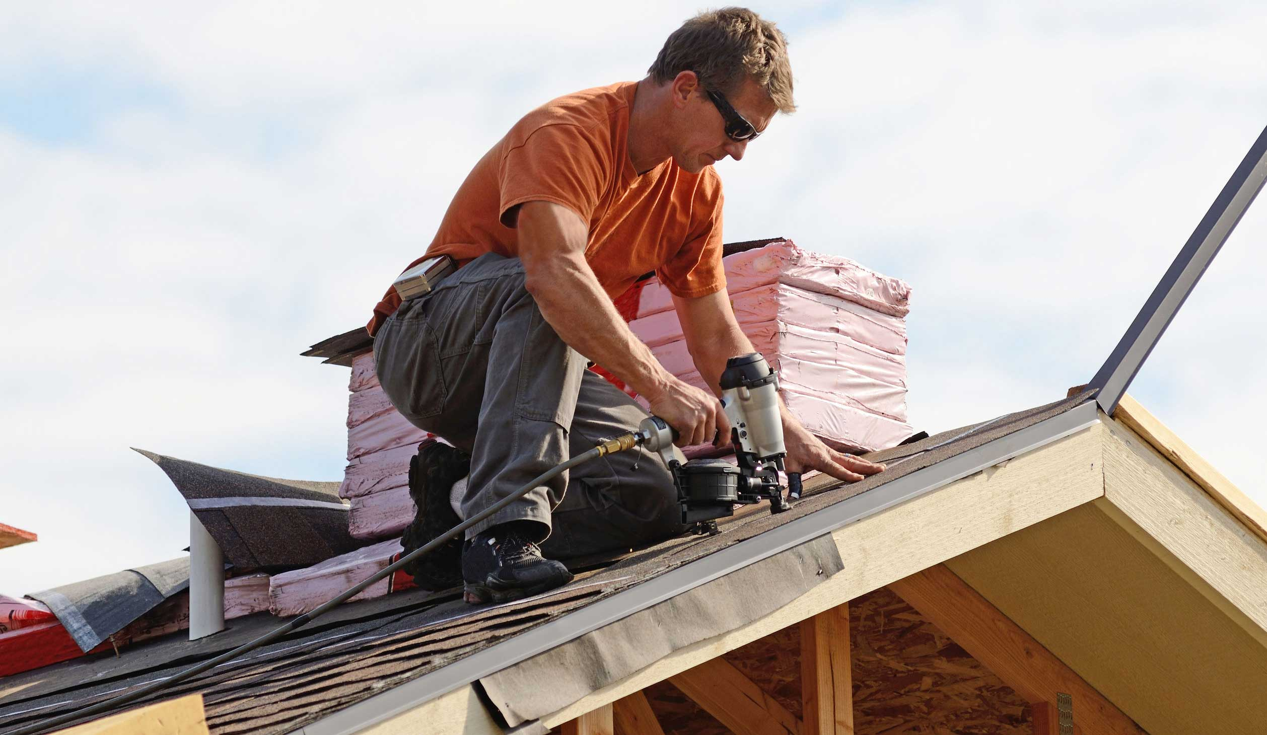 a roofer from michael bange roofing fixing a roof in pembroke pines