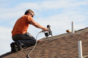 Michael bange roofing Roofer putting shingles on a roof