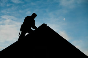 Michael Bange Roofing worker repairing a roof in coconut creek